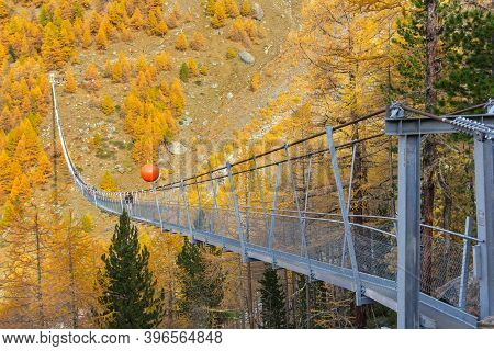Randa, Switzerland - October 27, 2019: The Charles Kuonen Suspension Bridge In Mettertal, Valais, Sw