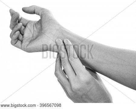 close up woman hands checking the heart rate pulse on the wrist, isolated on white background