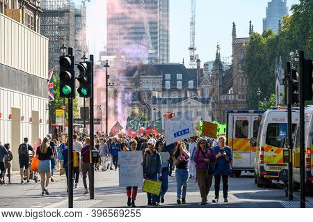 London - September 20, 2019: Protesters With Homemade Banners In Front Of Crowds And Red Smoke In Pa