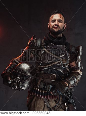Cheerful And Smiley Post Apocalyptic Fighter Dressed In Ragged And Dirty Armour Holding Helmet In Da