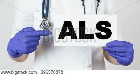 Medicine And Health Concept. The Doctor Points His Finger At A Sign That Says - Als. Amyotrophic Lat