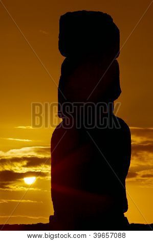 Silhouette Of A Moai Against Orange Sunrise