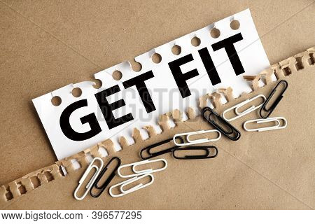 Get Fit, Text On White Paper On Torn Paper Background