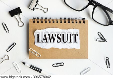 Lawsuit, Text On White Paper Over White Background