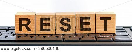 Reset Word Made With Building Blocks On The Black Keyboard