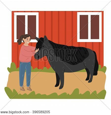 Happy Small Girl Standing And Petting Black Pony On Farm