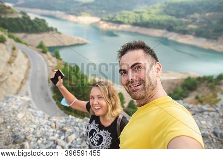 A Couple In Love Takes Selfie Photo Portrait Among Mountains At Dim Cay Reservour, Alanya. Happy Hip