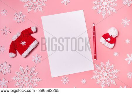Paper Blank On Pink Coral Background With Christmas Decoration . New Year Resolutionconcept Copyspac