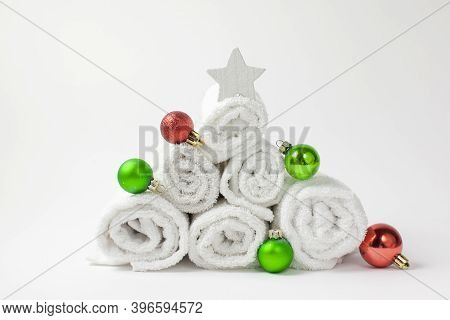 Christmas Composition With Towels, Christmas Balls And White Star. Christmas Tree From Towels. Chris