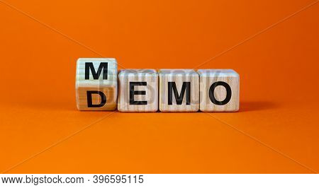 Turned Cube And Changed The Word 'demo' To 'memo'. Beautiful Orange Background. Business And Demo An