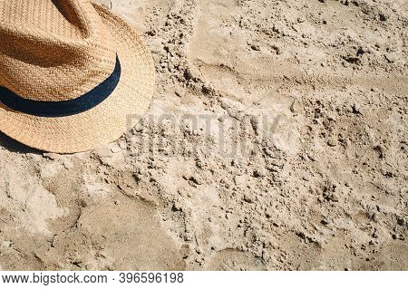 Summer Hat On Sand. Summer Beach Background. Holiday By The Sea. Vacation By The Ocean Background.
