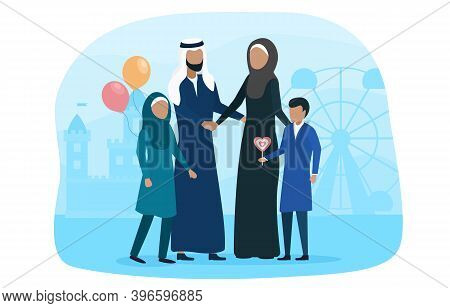 Muslim Family Walking With Kid In Amusement Park. Concept Of Happyi Slamic Family Spending Time Toge