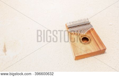 Kalimba Or Mbira Is An African Musical Instrument. Kalimba Made From Wooden Board With Metal, Play O