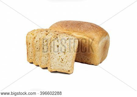 Fresh Bakery Product. Bread. White Uniform Wheat Bread Isolated On White Background. Top View And Co