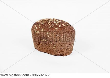 Fresh Bakery Product. Bread. Cereal Bun With Bran, Sunflower And Flax Seeds Isolated On White Backgr