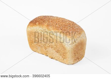 Bakery Product. Fresh White Molded Bread With Sesame Seeds Isolated On White Background. Top View An