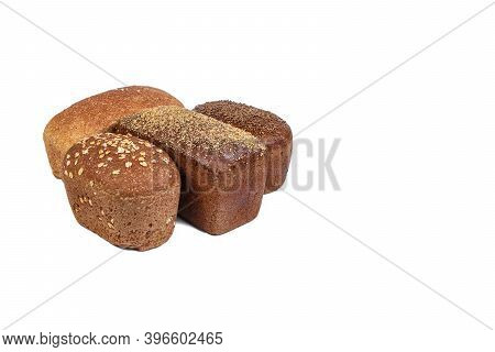 Bakery Product. Bread. Beautiful Composition With Different Bread On A White Background. Isolate. Sp