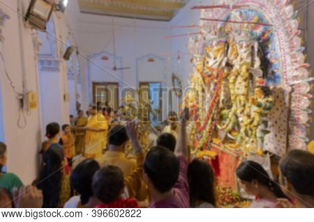 Blurred Image Of Worshipping, Flowers Are Thrown, Prayers Made And Pushpanjali Being Offered By Hind