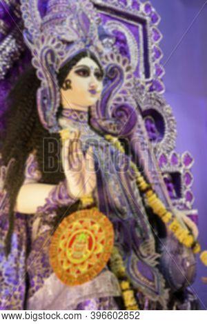 Bluured Image Of Blessful Hand Of Clay Idol Of Goddess Saraswati At Kolkata, West Bengal, India. Sar