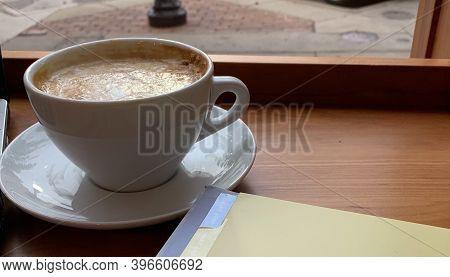 A Warm Caramel Macchiato Served At A Quaint Coffee Shop