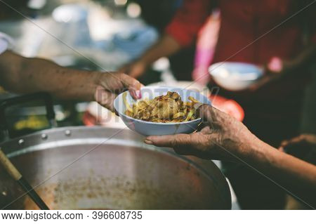 Beggar Begs Food From Donors: The Concept Of Hunger Hunger: : The Concept Of Feeding