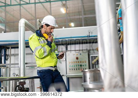 A Machine Engineer Is Checking The Availability Of A Machine For Sterilizing Food Products. Machine