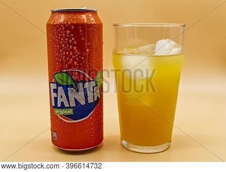 Bologna / Italy - November 26, 2020: Can And Glass Of Fanta Soda With Ice And Water Droplets.