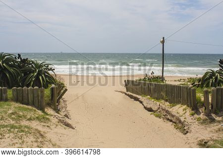Wooden Poles Marking The Edge Of The Vehicle Entrance At Beach