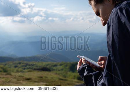 Woman Looking At Cell Phone. Woman Looking At Cell Phone Message. Woman Watching Cell Phone While Hi