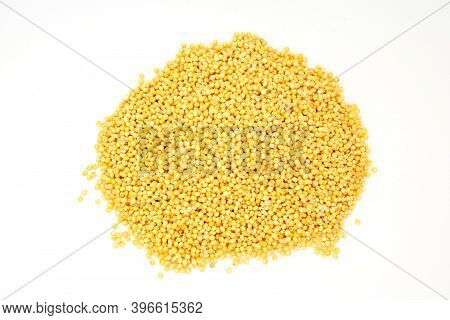 Heap Of Millet Groats On White Background
