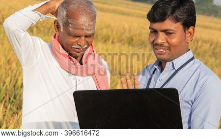 Confused Indian Farmer Scratching His Head While Banker Or Corporate Government Officer Discussing O