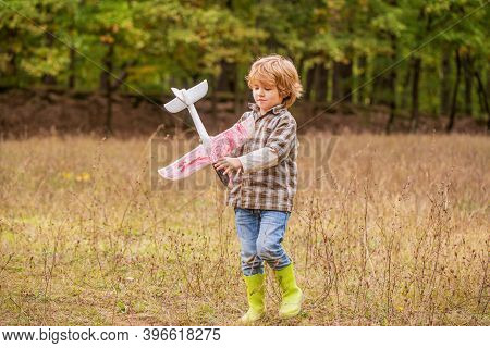 Little Kid Dreams Of Being A Pilot. Child Playing With Toy Airplane. Happy Child Playing. Happy Chil