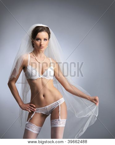 Young sexy bride in erotic lingerie poster