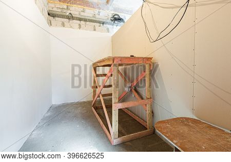 Wooden Board In Room And Construction Tools Are In An Apartment During On The Construction, Overhaul