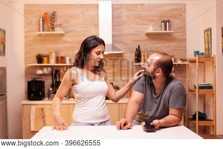 Wife Suspecting Husband Of Cheating While Having A Conversation With Him In Kitchen. Heated Angry Fr