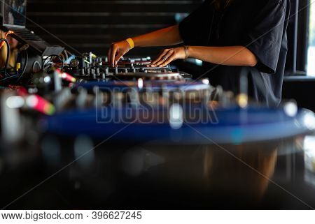Professional Night Club Dj Playing Popular Musical Tracks On Party.pro Djs Setup On Concert Stage In