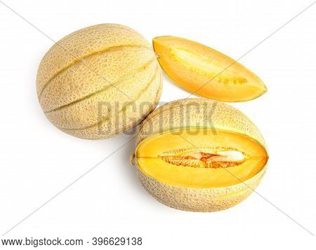Tasty Fresh Cut And Whole Melons Isolated On White, Top View