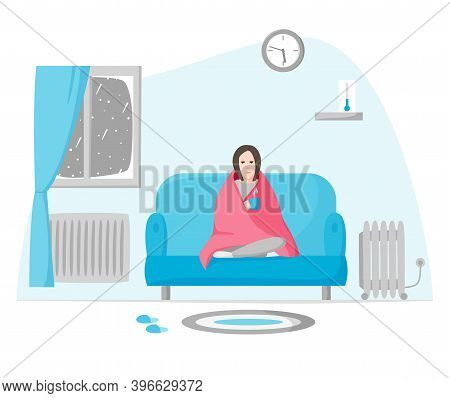 Freezing Woman In Cold Apartment In Winter. Girl Wrapped In Blanket Sits On Sofa. Using Radiator And