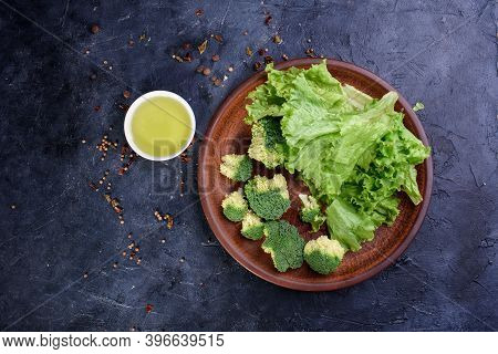 A Plate Of Healthy And Delicious Food From Fresh Lettuce, And Cabbage. Useful Fiber For The Body In