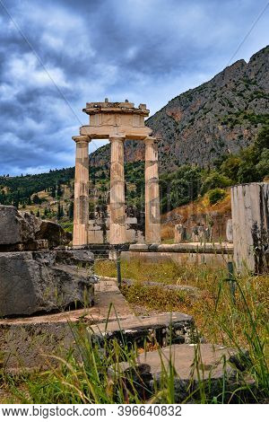 Vertical View Of Ruins Of Tholos Of Ancient Greek Goddess Athena Pronaia In Delphi, Greece. Doric Co