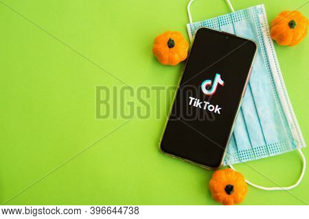 Tver, Russia - September 19, 2020: Tiktok App On The Smartphone Screen And Medical Protective Mask O