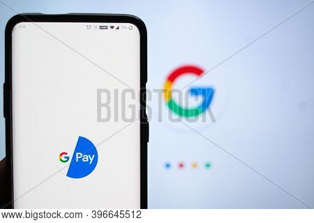 Google Pay App Logged In On A Mobile Infront Of A White Screen With Google Symbol