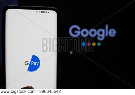 Google Pay App Logged In On A Mobile Infront Of A Black Screen With Google Symbol