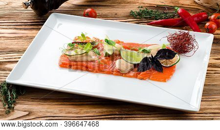 Salmon Fillet, Creative Serving Salmon Sashimi With Lime And Basil On Wooden Background. Keto Friend