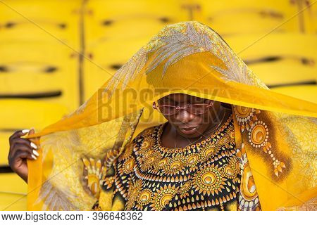 African Woman Holding Her Yellow Shawl In The Independence Square Grandstand In Ghana West Africa