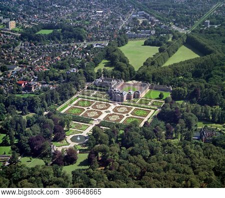 Apeldoorn, Holland, July 11 - 1990: Historical aerial photo of the Loo palace and gardens in Apeldoorn, Netherlands, built by the House of Orange-Nassau