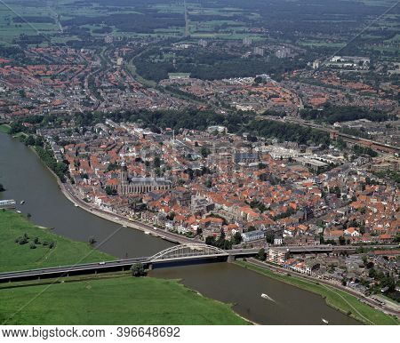 Deventer, Holland, July 11 - 1990: Historical aerial photo of the city Deventer situated on the east bank of the river IJssel and Wilhelminabrug