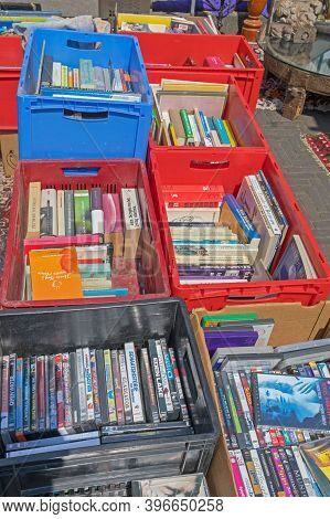 Amsterdam, Netherlands - May 16, 2018: Dvd Discs Games And Books In Boxes At Flea Market In Amsterda