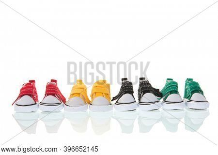 Colorful row canvas sneakers isolated over white background