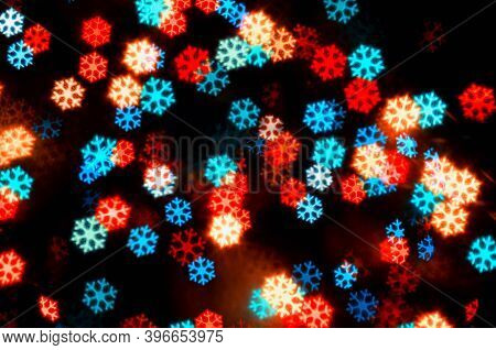 Christmas festive background. Christmas lights. Blurred snowflakes bokeh Christmas background, festive Christmas multicolor bokeh with snowflakes, blurred Christmas  bright abstract bokeh